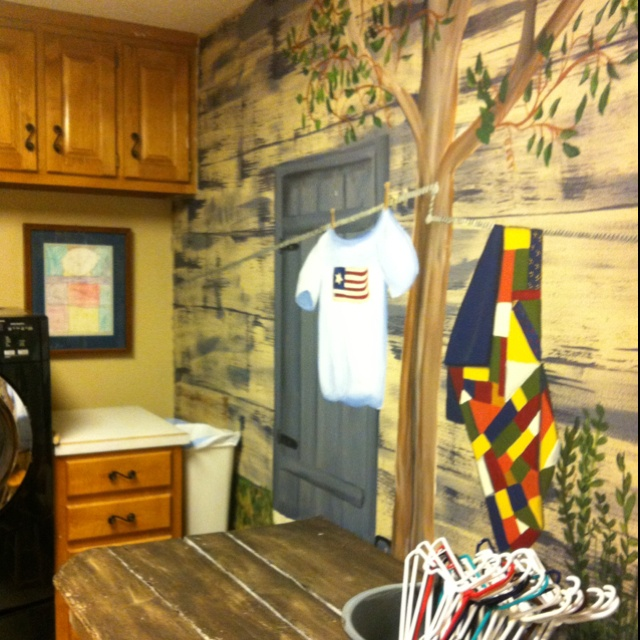 Painted mural on laundry room wall.