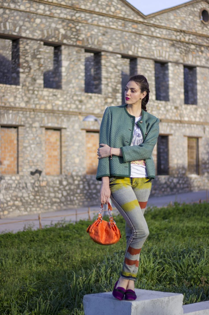Bold colours. Striped jeans, oxfordshoes, chanel tweed style jacket, and orange bag