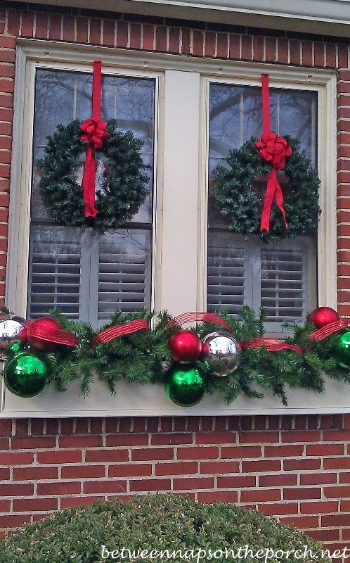 Windowboxes decorated for Christmas from Between Naps on the Porch
