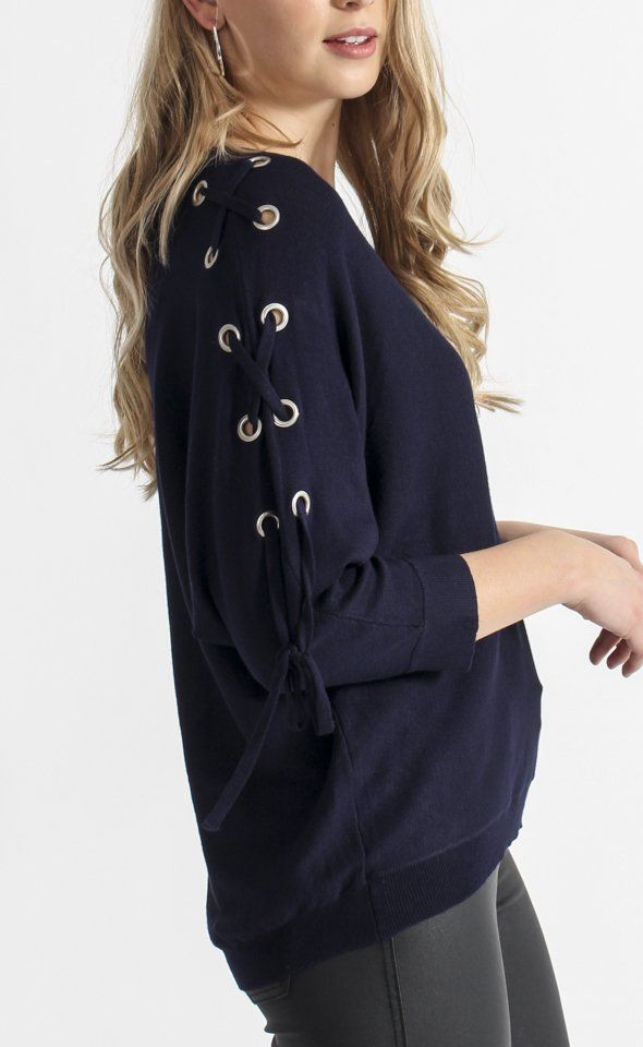 Eyelet Sleeve Batwing Sweater | Cut for movement, this batwing sweater will bring an edge of drama to your look. Lace up sleeves with eyelet detail give this style a contemporary feel.