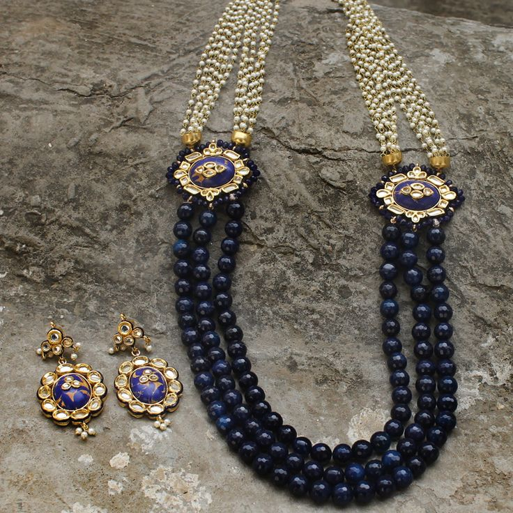 Mughal Inspired Gold Plated Blue Necklace studded with Simulated Kundan and Faux Pearl BeadDesigner Gold Plated, handcrafted with high quality Kundan.necklace