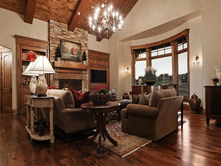 Traditional Living Room Iron Chandelier Dark Wood Trim Light Walls