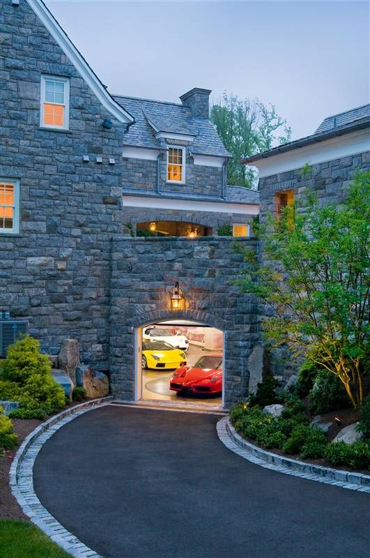 NJ house - here is the view from the backyard to the lower (underground)  garage and above it is the upper level garages (the single car garage is to  the ...