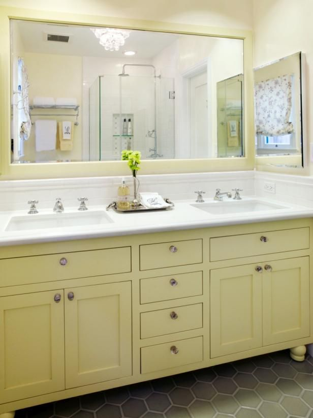 Yellow and White Cottage Bathroom With Chandelier