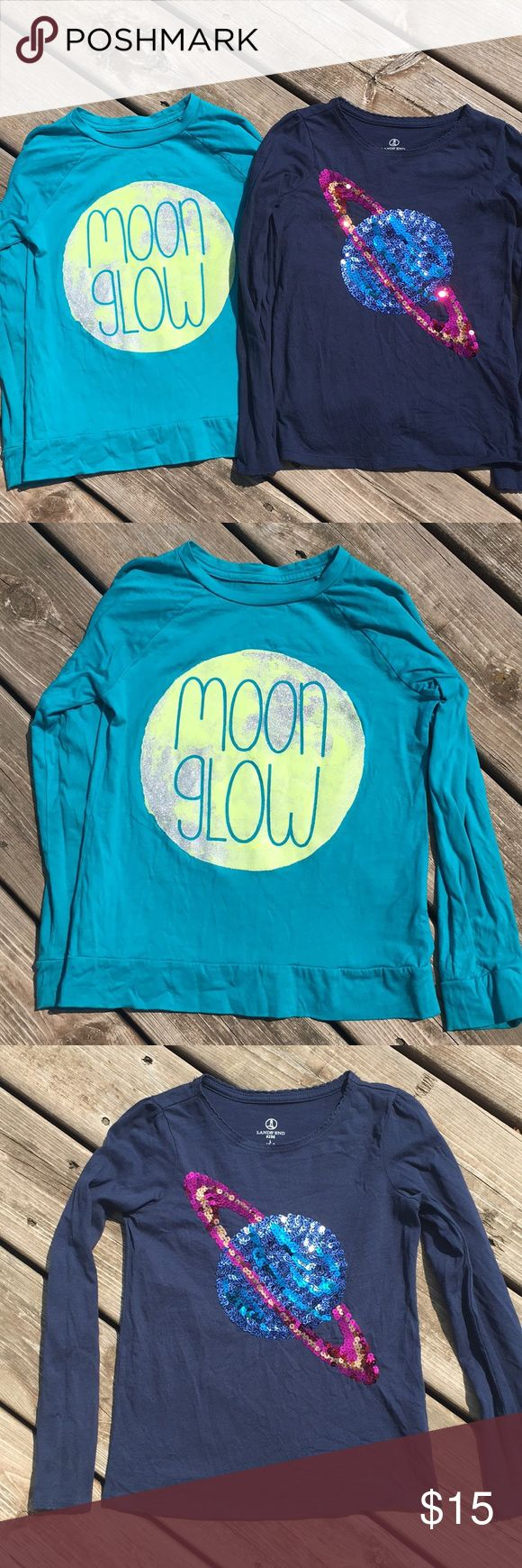 Lands End kids bundle of long sleeve tees Adorable Land End kids long sleeve tees bundle. Both are in excellent condition with no stains or holes.  The moon glow tee is teal and the moon graphic design glows in the dark.  The navy tee features a sequin Saturn pattern.  Both girls large (6x-7) and 100% cotton. Lands' End Shirts & Tops Tees - Long Sleeve