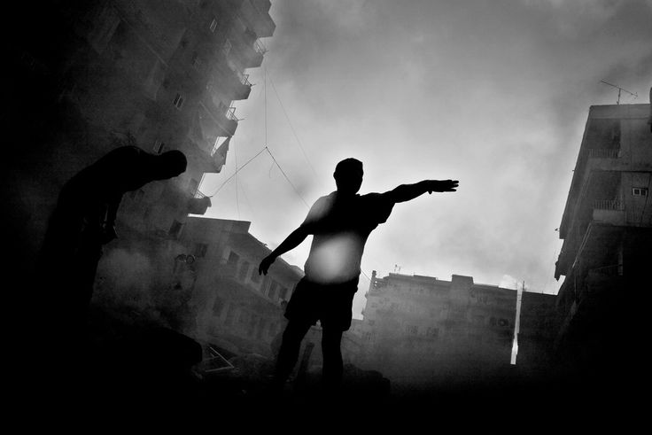 Paolo Pellegrin. LEBANON. Tyre. July 26, 2006. Moments after Israeli aircraft hit a building in downtown Tyre.