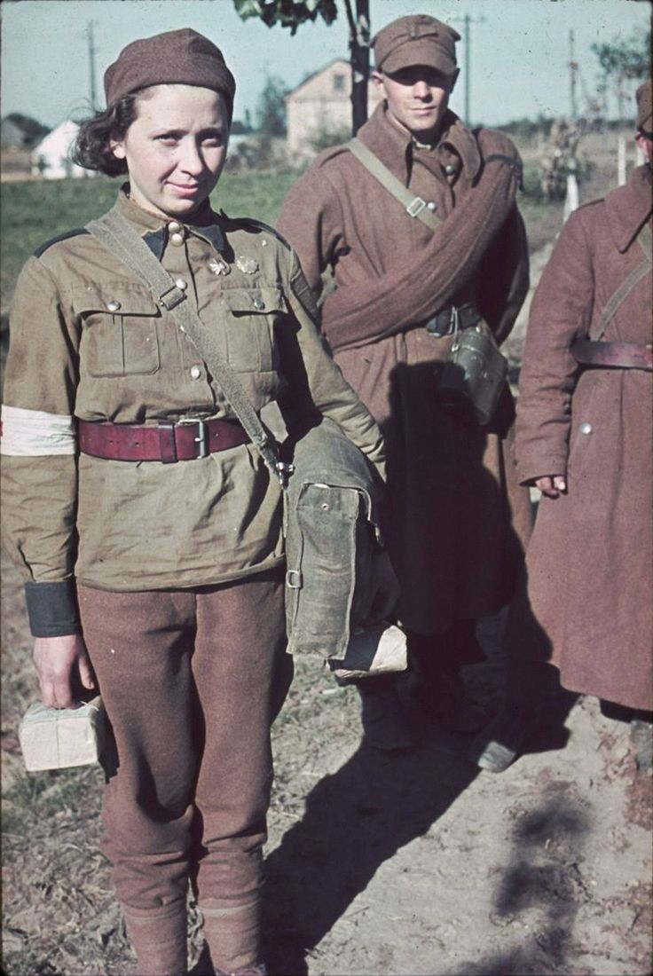"""worldwar-two: """" Polish POWs stand with a Red Cross nurse after being captured by German forces during the invasion of Poland, 1939. [x] """""""