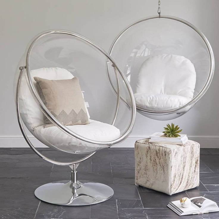 Eero Aarnio designed the original hanging Bubble chair as a chair with the light inside it, a transparent ball where light comes from all directions. Our Bubble inspired chair on a stand allows you to enjoy this iconic styled piece in any home, without the need for making any alterations to your ceiling and willl add a touch of modernist style to any decor. Comes with cream coloured woven fabric cushions.Constructed in a high quality 10mm thick clear acrylic with 2 removable and washable…