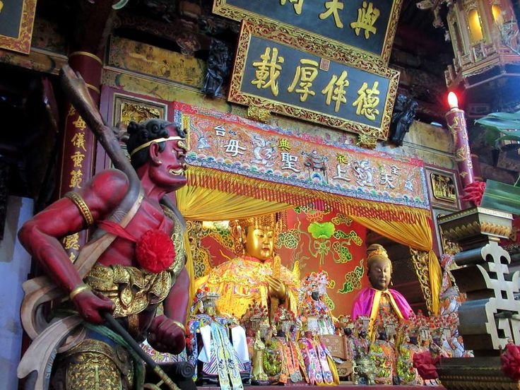 A guardian demon watches over a 300-year-old gilded statue of the Chinese sea goddess Mazu at the Grand Mazu Temple in Tainan, Taiwan.