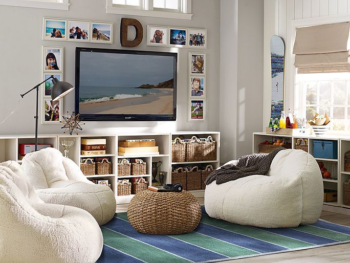 Teen Lounge Area. Love the Bookshelves lining walls with baskets. Bean bag lounge area with carpet. Pictures with Monogram Letter.