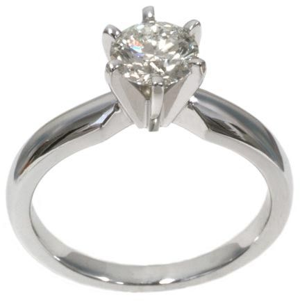Unique Diamond solitaire engagement ring with ct round in k white gold