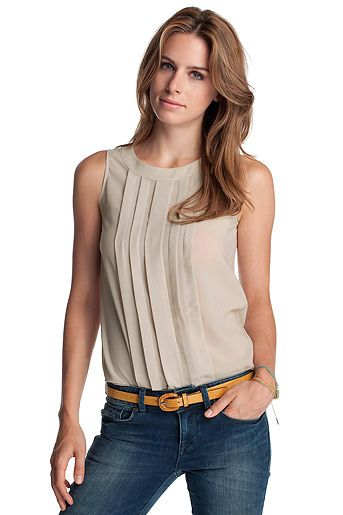 I like this top just in a brighter color and the rinse of the jeans.