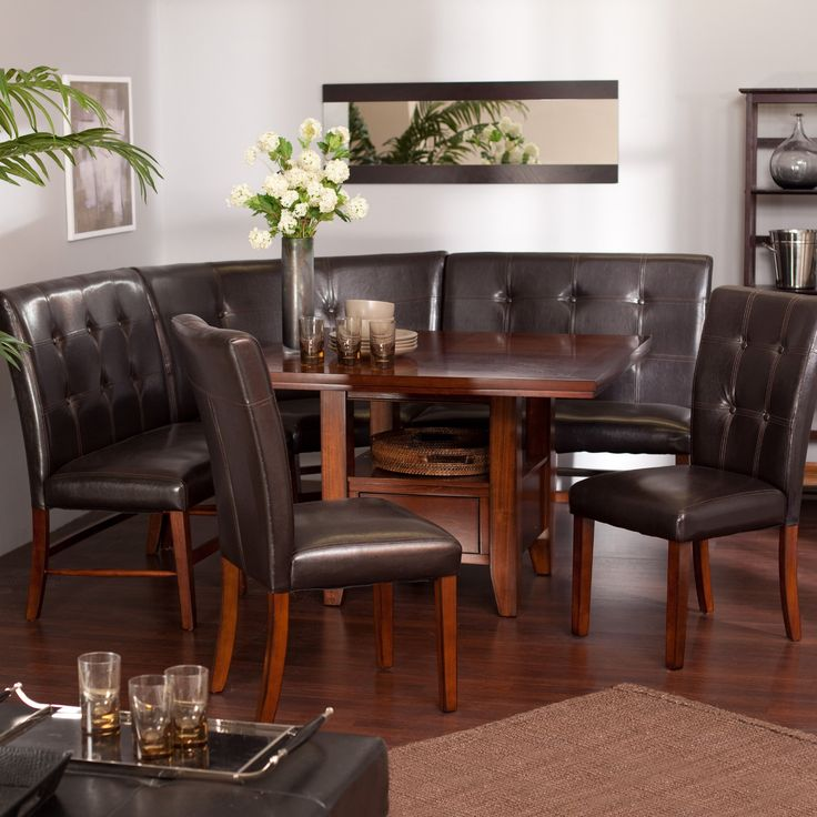 This breakfast nook unit includes the wood table, 2 dining benches, corner bench and two chairs.