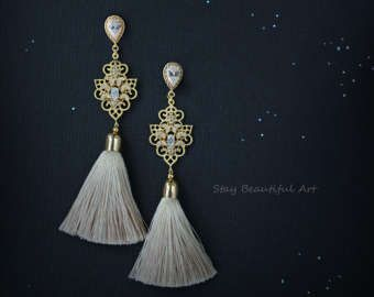 Cream color Natural Silk Tassels with Gold Plated Details Cubic Zirconia paved.