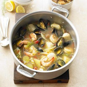 Seafood Bouillabaisse ~ Tender shrimp, scallops, and mussels bubble with saffron, cayenne, and veggies in a savory vegetable broth. A stunning but healthy holiday soup worthy of Christmas dinner!