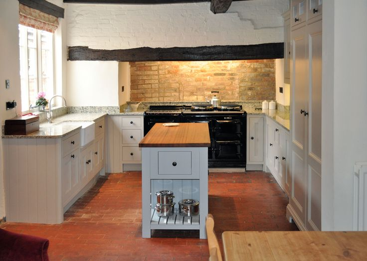 a kitchen fitted around a very uneven floor in a listed