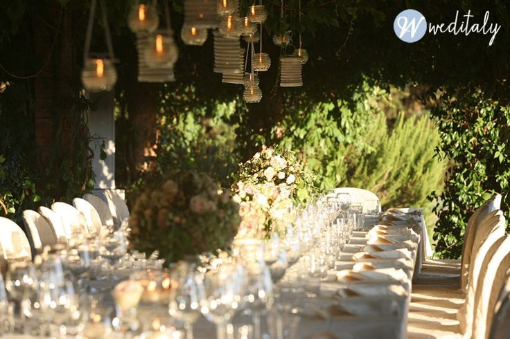 Mixed hanging lanterns over long table
