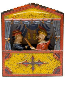 Circa 1884: a typical Punch and Judy theatre, scenery, curtain and all. 📌 📍
