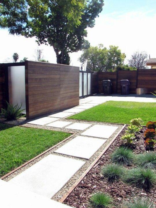 Wooden fence & cement walkway