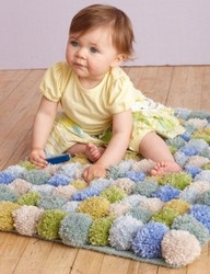yarn ball rug    Lion Brands Yarn website have one. Just get a mesh mat bottom from a craft store and sew on pom poms...it really is that easy! Same craft store can sell you a pom pom maker too!