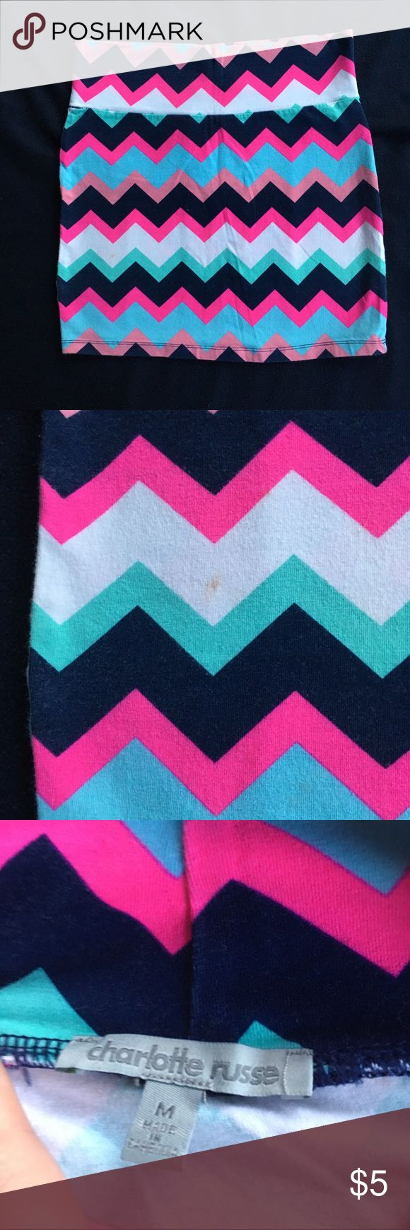 Multi-colored chevron mini skirt Chevron printed mini skirt. The colors are navy, white, coral, hot pink, mint green and robin's egg blue. Very fun and colorful! Fabric has a lot of stretch but this fits SMALL. Small makeup dot on the wearer's right side; very subtle. Add this to any bundle and I will reduce the price to $3.           p Charlotte Russe Skirts Mini