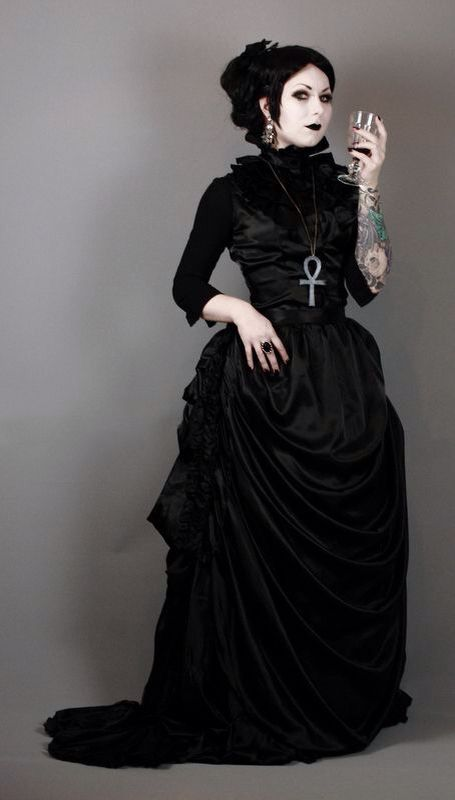 Neo-Victorian Gothic, Black Goth Women's dresses, american or European and  it looks Hightower middle class, this reminds me of the Adams family.