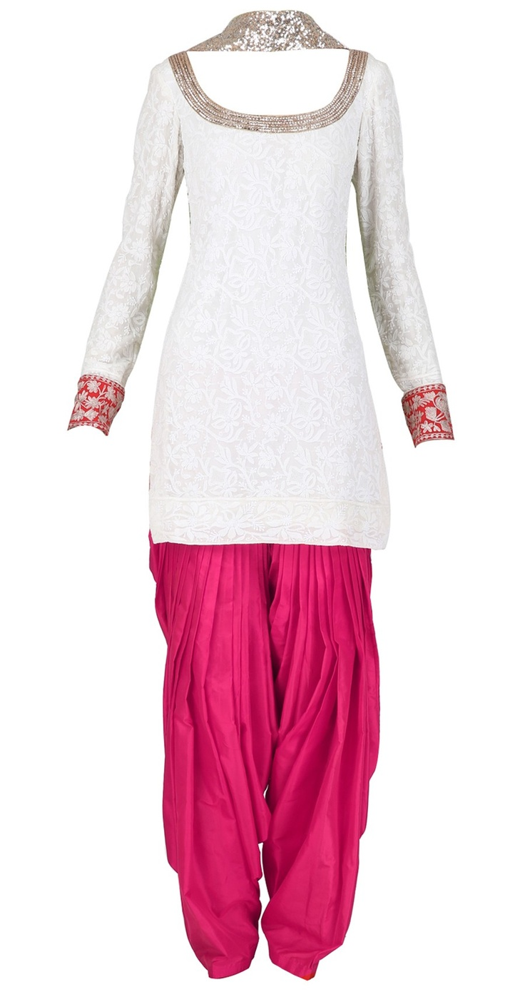 striking punjabi suit with color blocking: white kameez with fuchsia salwar
