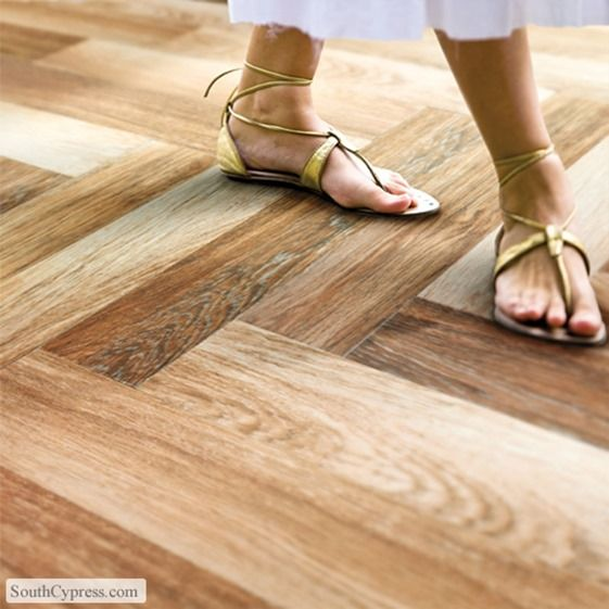 hardwood lookalike tile floor, thinking this would be warm toned and practical for pool house side of outside building.