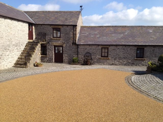 Stylish driveways can be made on Daltex Yellow 2-5mm Resin Bound: Resin Bonded Aggregates: