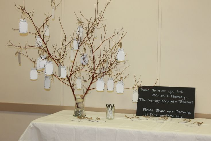 funeral ideas - Memory tree with tags for guests to write their messages- memorial ideas