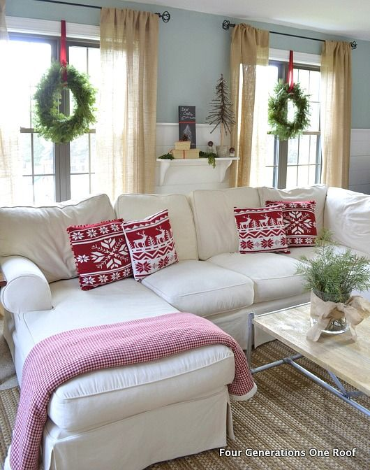 Wreathes hung in the windows by ribbon + linen/burlap curtains. (a previous Pinner said -- How to hang a shelf and create a mantel behind your couch