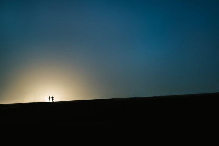 Sunset silhouette engagement.