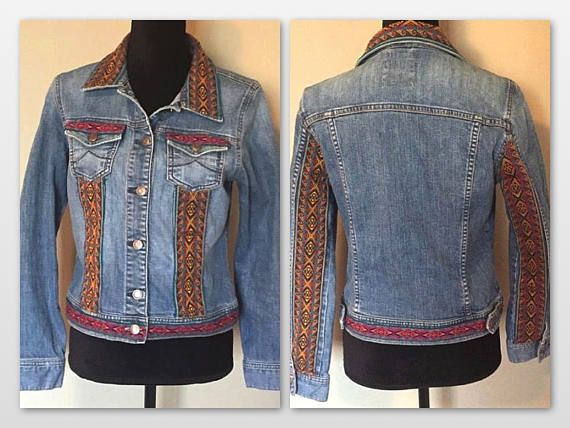 Customized bohemian tribal pattern embellished denim jacket. This is the perfect jean jacket to throw on with everything. Size: Medium Denim Fabric: 99% Cotton 1% Spandex Beautiful tribal embroidery on front and back. Brand: Vintage Old Navy (Customized) This item is not new and