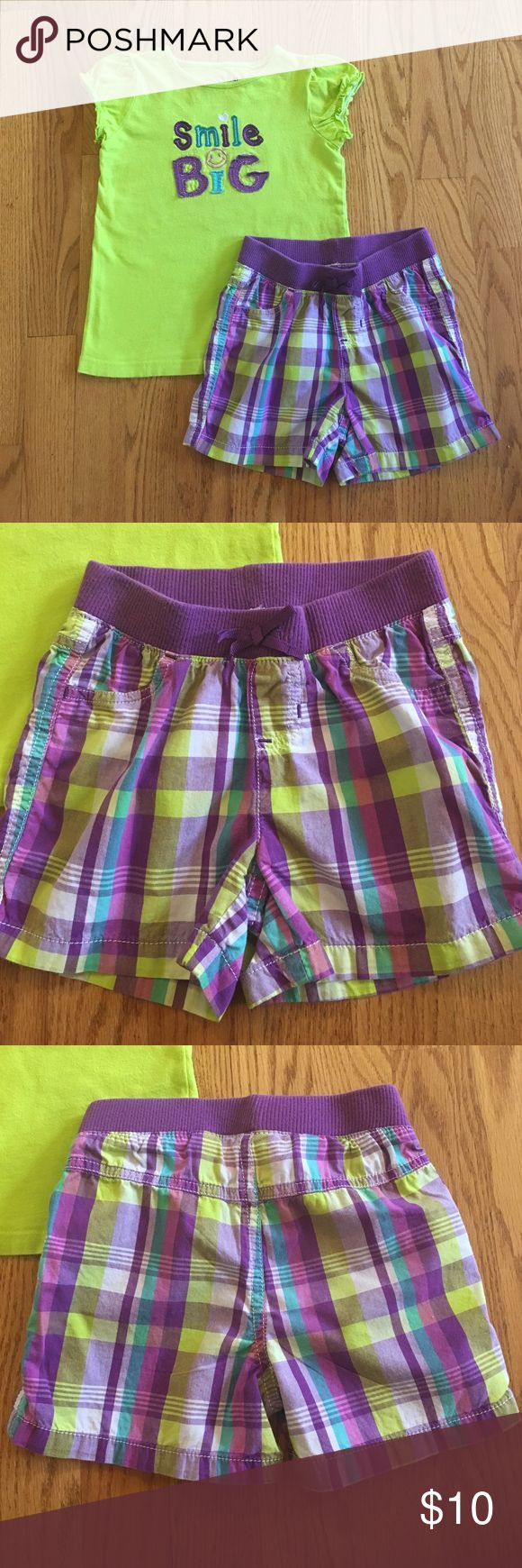 Girl's 4T Jumping Beans matching set This Girl's 4T Jumping Beans matching set includes purple and green plaid shorts and lime green t-shirt with the words Smile Big appliquéd on the front. T-shirt has slight pilling. Comes from a smoke free and pet free home. Jumping Beans Matching Sets