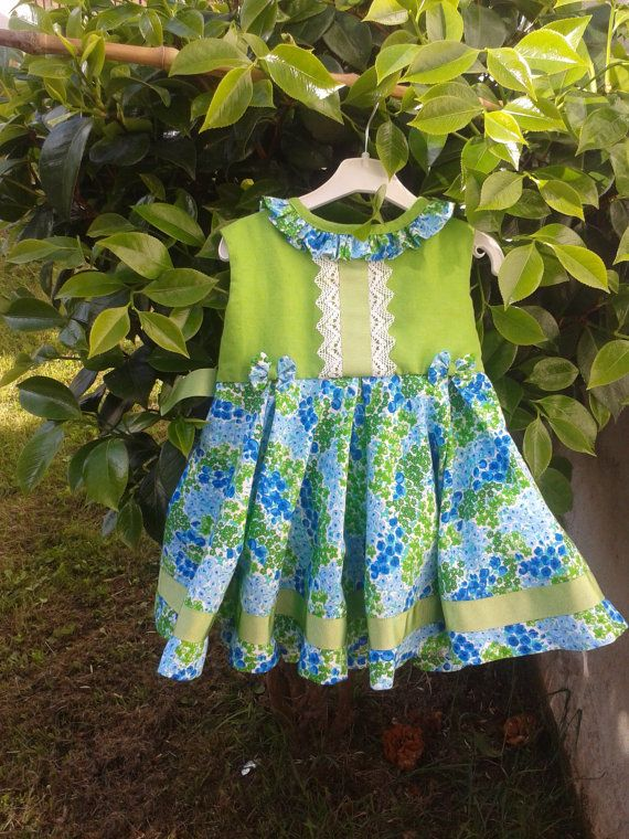 baby girl in green baby girl in blue colourful baby dress