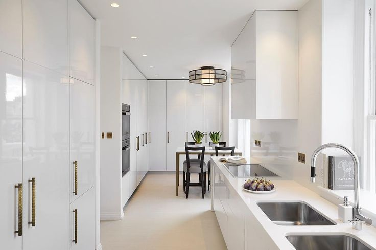 The clean contemporary kitchen at our Holland Park project. The doors open and then slide back into pockets to reveal extra work surface with kettle, toaster etc so the rest of the kitchen can be kept tidy and streamline #interiorarchitecture #interiordesign #luxuryinteriors #interiorstyling #laurahammett