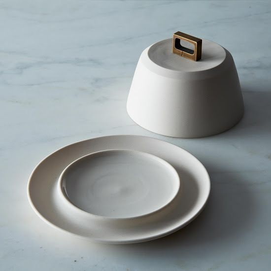 BRONZE HANDLE BUTTER DISH $110  We love the simple, beautiful work of Portland based ceramicist Lisa Jones of Pigeon Toe. This hearty porcelain butter dish is enhanced by a square bronze handle giving it a modern but timeless elegance.