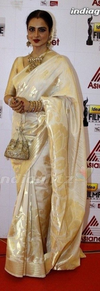 REkha in white gold silk saree