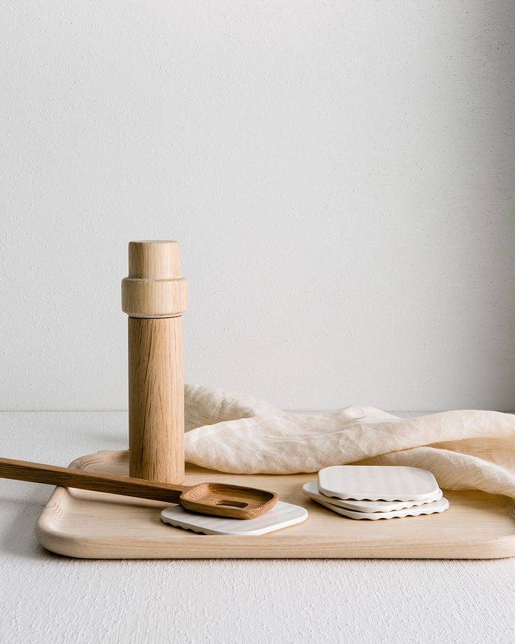 Welcome functional accessories to your kitchen; think heat protecting trivets, coasters, tea towels and timber salt and pepper grinders.