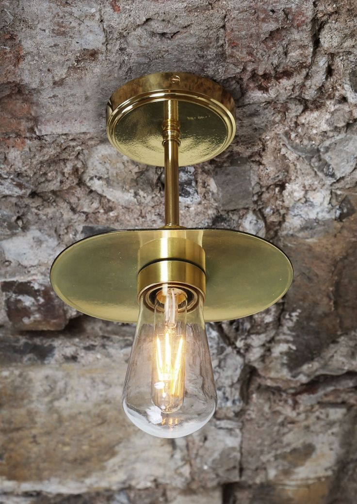 This contemporary kwaga ceiling light by irish designer mullan lighting offers a sophisticated touch to any bathroom or powder room and can be attached to