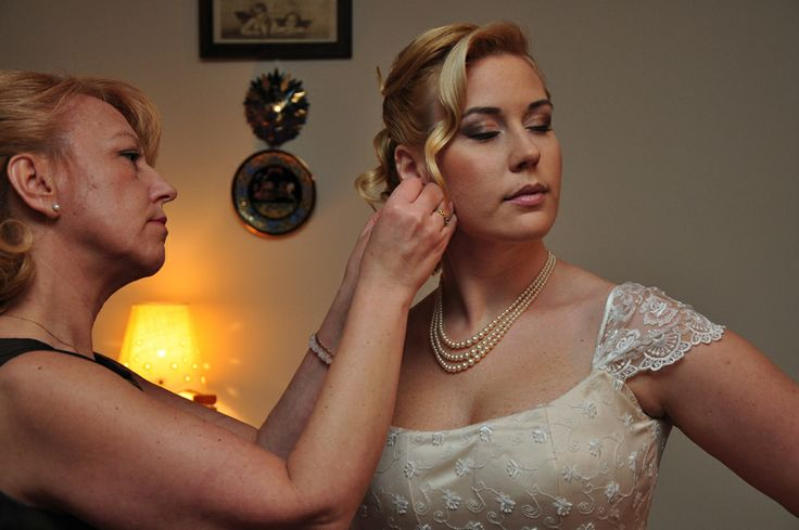 preparing for the wedding - mother helps for the daughter