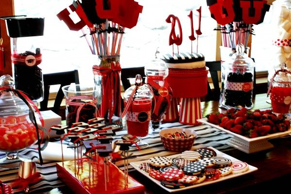 Gorgeous graduation party dessert table with a red, black, and white color scheme.