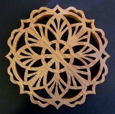 Just Me!: Trivet - Also From An Ornament Pattern http://brenda62052.blogspot.com/2012/11/trivet-also-from-ornament-pattern.html# - Scroll Saw