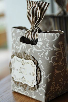 Striped ribbon with a patterned bag.in a sophisticated taupe and white color palette. #giftwrap #ribbon
