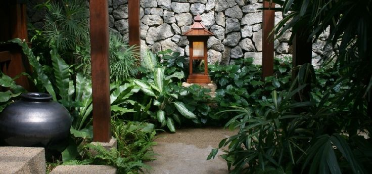Creative Landscape Design In The Front Yard With Stone Walkway and Pavers