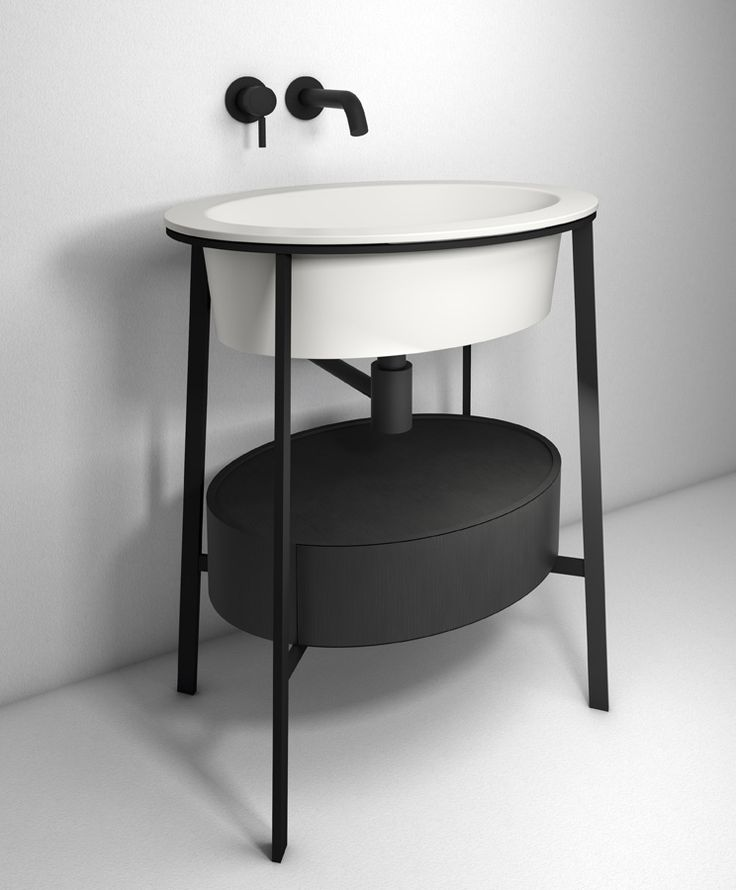 Catino bathroom collection by CIELO, made up of a ceramic washbasin in the Talcum finish, white Carrara marble top, and steel structure with a matte black finish. Catino's design takes inspiration from the past to give a modern interpretation of one of the most iconic bathroom furnishing pieces of the early 20th century. Design by Andrea Parisio and Giuseppe Pezzano. #bathroomdesign #ceramic #interiordesign #HandMadeinItaly #Inspiration