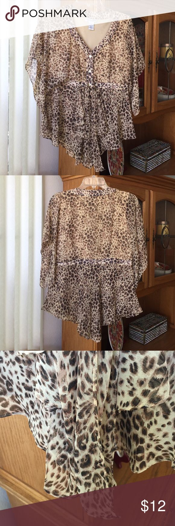 Leopard Tapered Blouse Beautiful leopard blouse with buttons down the front. Fully lined and has tapered fabric that hangs shorter on the sides. In perfect condition! Newport News Tops Blouses