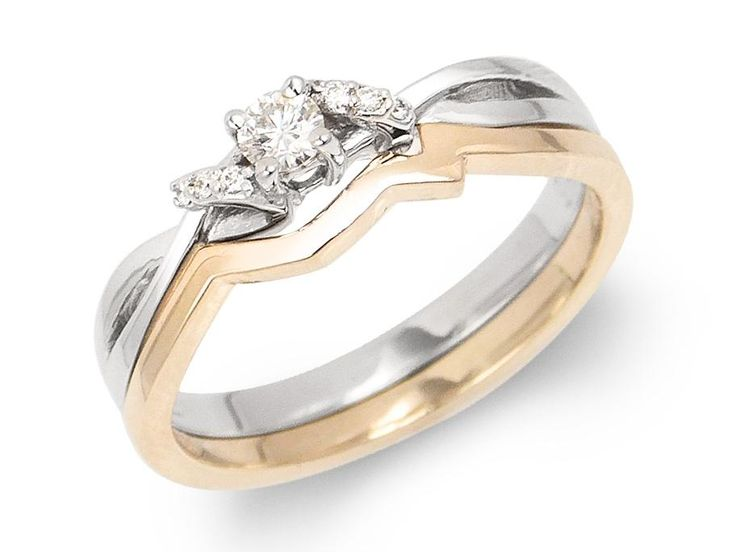 Center diamond bordered with 3 diamond on each ribbon and plain matching band. Center diamond weight: .09ct Total diamond weight: .11ct Gold: 14 karat