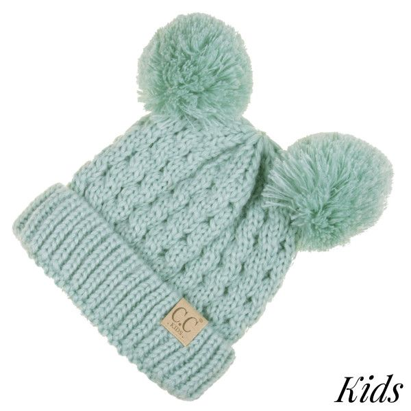b6265574cf9 KID-24  Chunky cable knit C.C Beanie with double pom. 100% acrylic. Measures  7