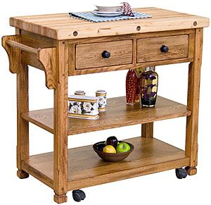 This charming butcher block cart features an extra thick top to withstand years of cutting, cooking and spills.  Perfect for the center of a kitchen as an additional work area, the cart also features casters for easy movement when needed, two top drawers for utensils, two spacious shelves for your larger kitchen items, and a towel holder.